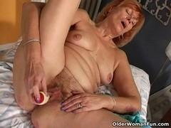 Redheaded granny Susan bonks her hirsute slit with a vibrator