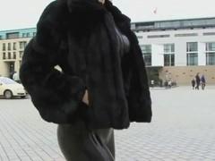Blonde german lady in spandex uniform goes for a walk