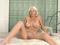 Breasty blonde coed rubs her moist pink love tunnel
