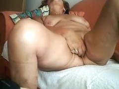 Gilf masturbates with a vibrator and rides grandpa on the sofa