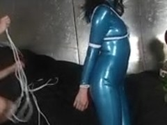 Doxy in blue latex costume gagged and tied