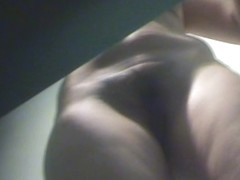 Fat lady exposing her small tits and bush on the voyeur camera