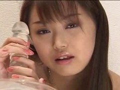 Cute Japanese slut plays with inflatable dildo