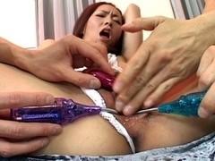 Horny Asian slut enjoys toy insertion