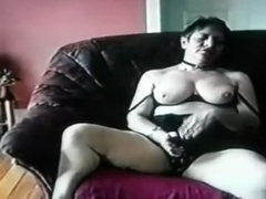 Aged chubby lady on the sofa masturbating on web camera