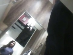 Changing room spy video with brunette in erotic bra