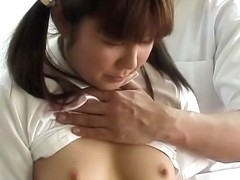 Japanese babe gets a sensual massage on the camera
