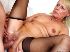 Mature lady's pussy worshiped by a young guy
