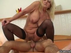 Old slut jumps on his lewd rod