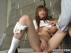 Horny Japanese teen pleases her pussy uncensored