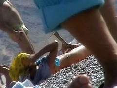 Hot red hair babe takes a nude sunbath at the beach