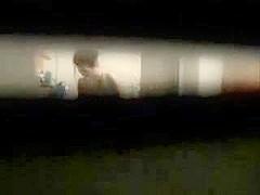 A voyeur spies through a window porno