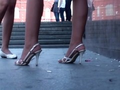 Bombshell in white shoes demonstrates her perfect legs