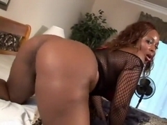 Voluptuous ebony woman has a black shaft pounding her sweet butt hole
