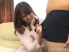 Alluring Japanese AV model makes a handjob and deepthroats
