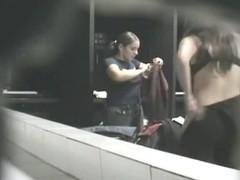 Hot dark-haired girl getting dressed