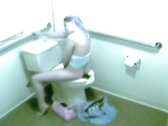 Hidden camera films a beauty masturbating on a throne room