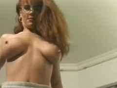 Hawt breasty secretary in glasses masturbates her moist slit
