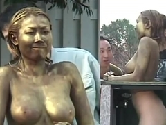 Busty Japanese whore in a kinky public display