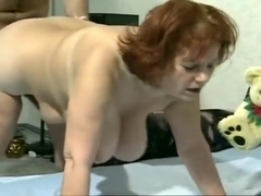 amazing mature redhead showing her boobs teetering