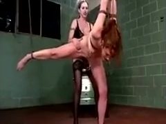 Dominatrix Hangs Slave On The Ceiling