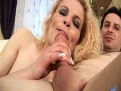 Big young cock getting a blowjob by a much older slut