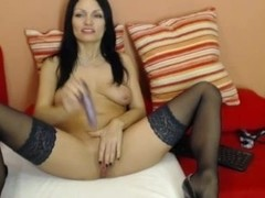 Hot MILF in stockings enjoys a hot masturbation