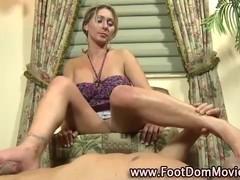 Footjob femdom babe rubs feet