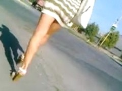 Hot slut in miniskirt caught in street candid video