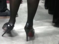 Black stilettos waiting for the train