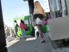 Skinny babe wears mini skirt in the voyeur upskirt vid