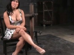 Shackled Asian slut's pussy and face hole used
