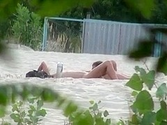 Voyeur tapes 2 nudist couples having sex at the beach
