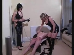 Sissy thrall gets caning from two evil dominas