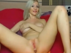 Blue-eyed blonde masturbating and dildoing her ass
