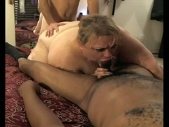 Fat slut enjoys two throbbing wangs
