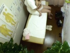 Shy asian recorded on a spy cam in massage room