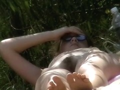 A nudist beach video with big dome tits and hairy pussies