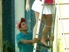 Candid camera voyeur presents cute girl with a round bum on the ladder.