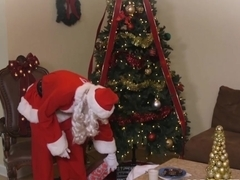 Busty milf getting banged by Santa under the Christmas tree