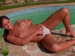Cathy Heaven masturbates outside and sucks a green dildo