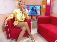 Blonde with fashionable hairstyle demonstrating her sexy legs