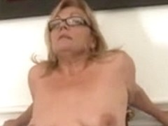Milf with small saggy tits and glasses