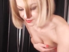 Gorgeous Blonde in Thongs Striptease