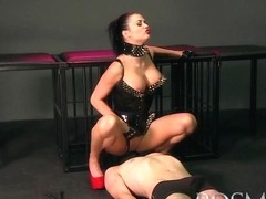 Slave boy licks Mistresses spit from the cage floor before a good beating