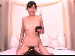 Cute dark brown with wonderful meatballs and bushy cookie rides a sybian