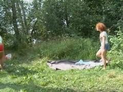 2 juvenile girlfriends engulfing giant strapon on the beach