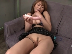 Jun Kusanagi is drilling her moistened pussy with a huge sex toy