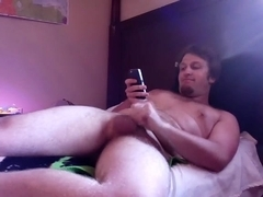 Cute male is jerking in the bedroom and memorializing himself on web cam