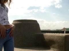 Brunette teen goddess rubs her whole body on the shore